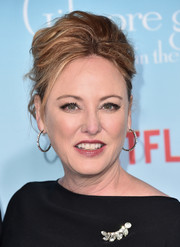 Virginia Madsen attended the premiere of 'Gilmore Girls: A Year in the Life' wearing her hair in a teased updo.