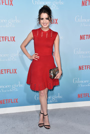 Laura Marano looked sweet and chic in a red fit-and-flare bandage dress by Ted Baker at the premiere of 'Gilmore Girls: A Year in the Life.'