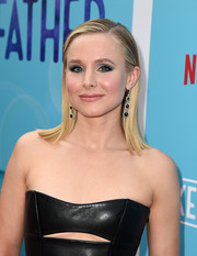 Kristen Bell sealed off her look with a pair of dangling gemstone earrings by Michael M.