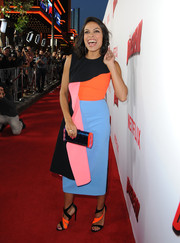 Rosario Dawson kept the multicolored theme going with a pair of two-tone strappy sandals by Tamara Mellon.