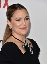 Drew Barrymore glammed up her simple 'do with a pair of Harry Winston diamond earrings.
