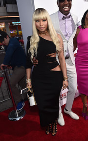 Nicki Minaj sent temperatures rising at the 'Barbershop: The Next Cut' premiere with this slashed one-shoulder LBD by Balmain.