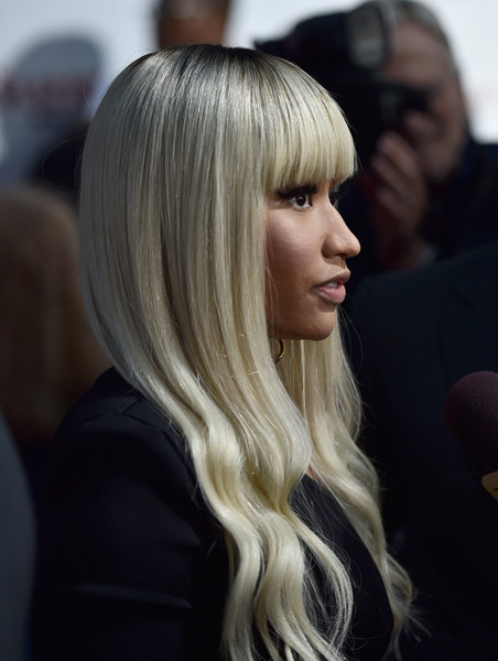 Nicki Minaj channeled Barbie with this blonde wavy 'do at the premiere of 'Barbershop: The Next Cut.'