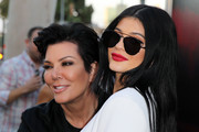 Kylie Jenner kept her eyes hidden behind a pair of black aviators while posing for photographers at the premiere of 'The Gallows.'