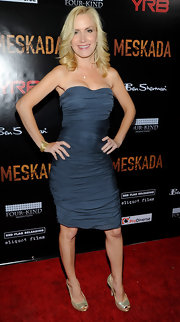 Angela flaunts her fantastic figure in this ruched gunmetal strapless gown at the premiere of 'Meskada.'