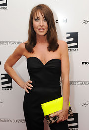 "President of Jimmy Choo, Tamara Mellon showed off her sleek side while walking the red carpet of the premiere ""Mother And Child. She paired her neon clutch with a simple jumpsuit."