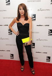 "Tamara Mellon showed off her sleek side while hitting the premiere of ""Mother And Child"". Her strapless jumpsuit was simple yet sleek."