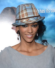 Judi Shekoni chose a colorful plaid fedora for her look at the 'Rogue' premiere.