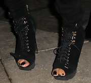 Teyana completed her look with killer lace up ankle boots. With treading on the button and suede texture—this boot was bound to catch our attention.