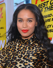 Joy Bryant completed her wild look with a hot red lip.