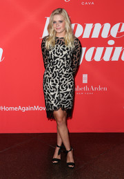 Ava Phillippe looked very mature in a black lace mini dress with a white overlay at the premiere of 'Home Again.'