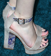 Taylor Sprietler's cool nude sandals with purple snakeskin trim complemented her purple pedicure.