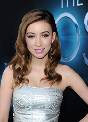 Christian Serratos chose a pale pink lip with a slight metallic sheen for her feminine red carpet look.