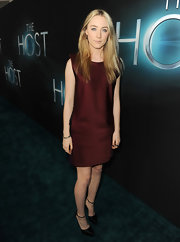 Saoirse Ronan played it safe on the red carpet with this maroon shift dress.