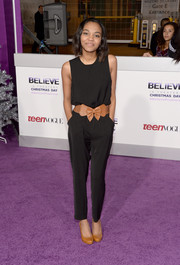 China Anne Mcclain kept it simple with a sleeveless black jumpsuit cinched with a bow-embellished belt during the premiere of 'Justin Bieber's Believe.'
