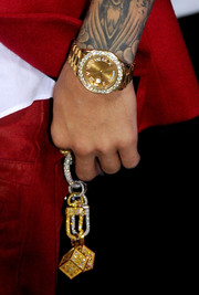 Justin Bieber flaunted a diamond- encrusted watch at the premiere of 'Justin Bieber's Believe.'