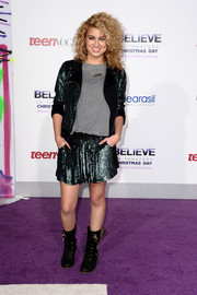 Tori Kelly sparkled in a sequined black moto jacket and a matching mini skirt at the premiere of 'Justin Bieber's Believe.'