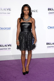 Gabrielle Douglas got all dressed up in a black strapless dress with a leather bodice and a lace skirt for the premiere of 'Justine Bieber's Believe.'