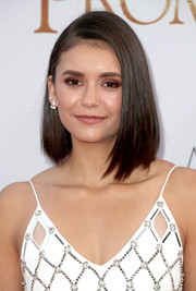 Nina Dobrev sported a cool and trendy asymmetrical lob at the premiere of 'The Promise.'