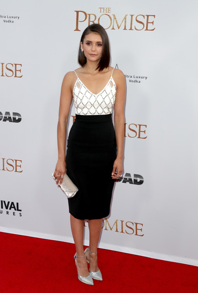 Nina Dobrev amped up the glamour with a pair of silver ankle-strap pumps by Soebedar.