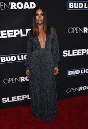 Gabrielle Union went for bold glamour at the premiere of 'Sleepless' in a sparkly gray Thakoon gown with a down-to-there neckline.