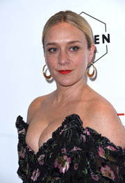 Chloe Sevigny kept it low-key with this center-parted bun at the premiere of 'The Dinner.'