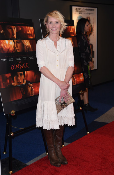 Anne Heche toughened up her dress with a pair of brown knee-high boots.