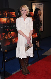 Anne Heche paired her dress with a tan snakeskin clutch by Jimmy Choo.