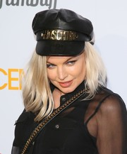 Fergie attended the premiere of 'Spaceman' wearing a black leather newsboy cap by Moschino.