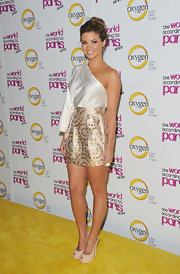 Amber Lancaster teamed her flirty asymmetric dress with ivory platform peep-toes.