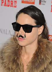 Aubrey Plaza clowned around at the premiere of 'Casa De Mi Padre' in a pair of wayfarers with a mustache attached to it.