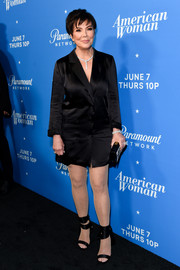 Kris Jenner matched her dress with a pair of black ankle-wrap sandals.