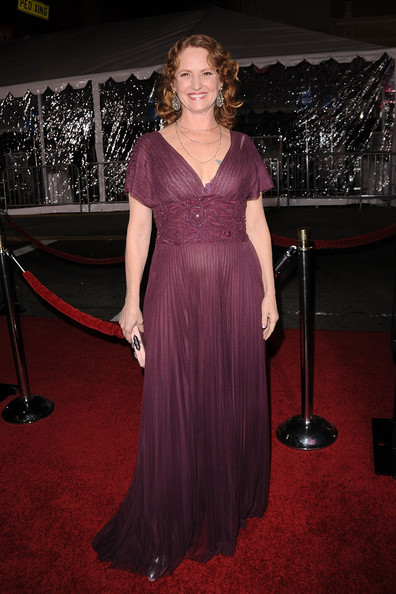 Melissa looks fabulous in this purple pleated evening gown.