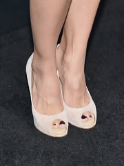 Elodie Yung showed off her plum pedi with these nude peep toes.