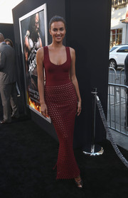 Irina Shayk flaunted her stunning figure in a low-cut, body-con burgundy evening dress by Alaia during the premiere of 'Hercules.'