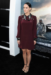 Jess Weixler chose a long-sleeve burgundy Prada shift featuring an embellished collar and yoke for the 'Interstellar' premiere.