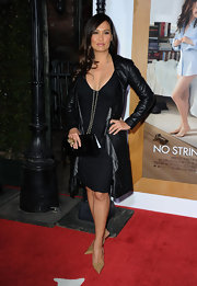 Tia wore a ruffled leather evening coat for this sizzling style.