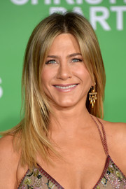 Jennifer Aniston paired her iconic 'do with gold chandelier earrings.