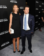 Rhea Durham had two arm candies at the 'Pain & Gain' premiere -- a white purse and her husband Mark Wahlberg.