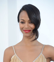 Zoe Saldana stunned from head to toe at the 'Star Trek Into Darkness' premiere. But what caught our attention was this gorgeous pinned updo that featured a single wavy strand to frame her face.