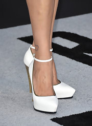 A pair of white ankle strap platform pumps added height and length to Catherine Bell's red carpet look.