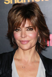 Lisa Rinna attended the premiere reception for 'Shameless' with sultry smoky eyes done in shades of metallic bronze.