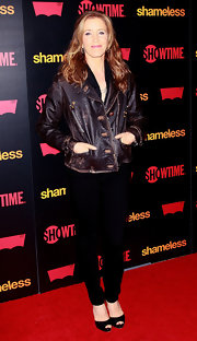 Felicity Huffman kept warm on the red carpet premiere of 'Shameless' in a distressed leather jacket.