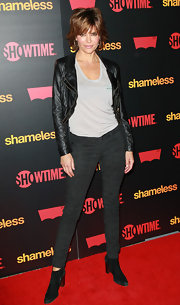 Lisa Rinna struck a sultry pose in a cropped leather jacket and a slouchy T-shirt.