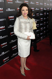 Joan Collins carried a ladylike white quilted clutch to the premiere of 'The Kennedys.'
