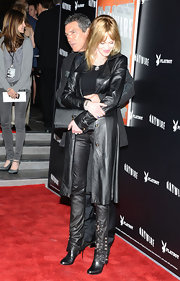 Melanie Griffith rocked head-to-toe leather, in a long coat and matching embellished pants.