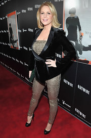 Carrie Keagan took to the red carpet in a daring jumpsuit paired with black platform pumps.