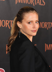 Estella Warren wore her lovely caramel locks in a sleek ponytail at the premiere of 'Immortals.'