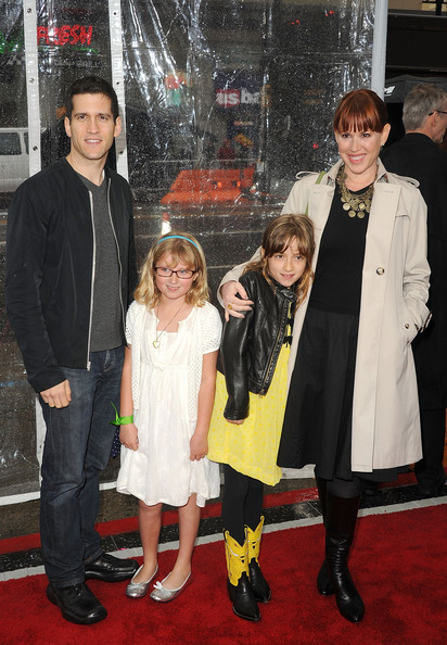 Molly Ringwald's black knee-high boots added a retro touch to her look.
