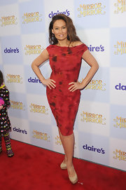 Tia Carrere's nude platform pumps looked perfect with her red dress at the premiere of 'Mirror Mirror.'